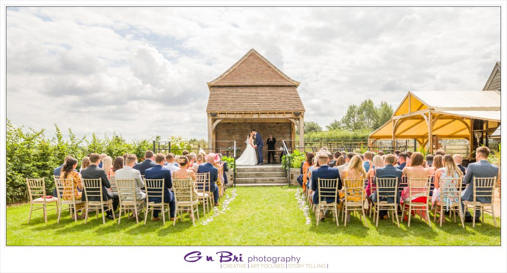 The First Kiss at The Barns at Redcoats Outdoor Wedding